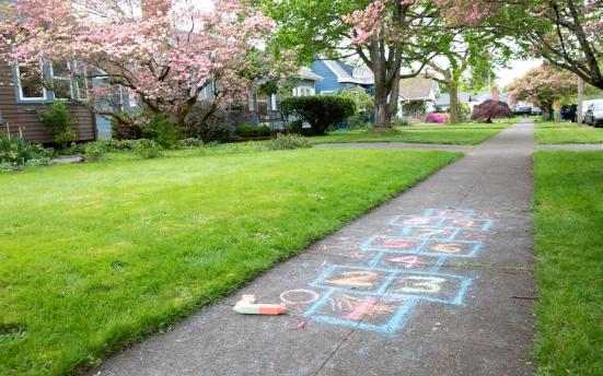 A sidewalk with chalk hopscotch