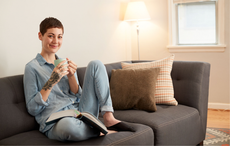 Person sitting on couch with tea