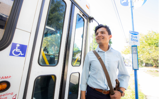 Person boarding trimet bus
