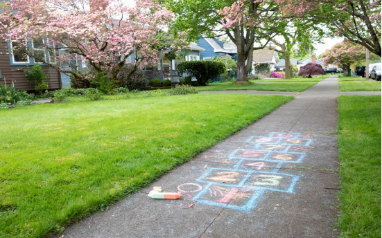 A sidewalk with chalk hopscotch